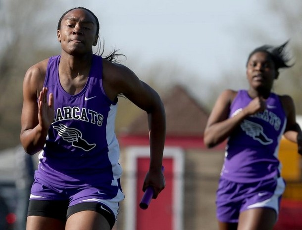 Kurt Hostetler/The Star Press Central's Jayla Scaife takes off after being passed the baton from teammate Nyla Carter. Their 4x100 team took the victory.
